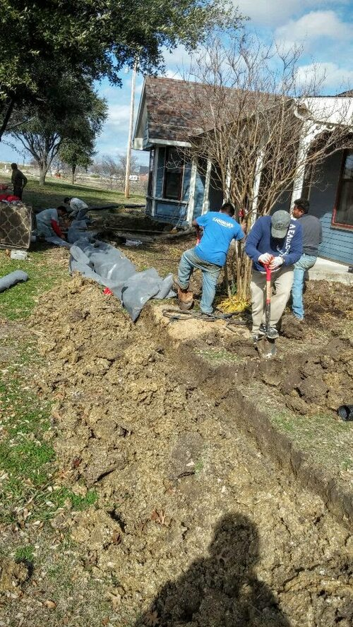 Drainage repair concrete slab repairs pier beam shimming for French drain collection box
